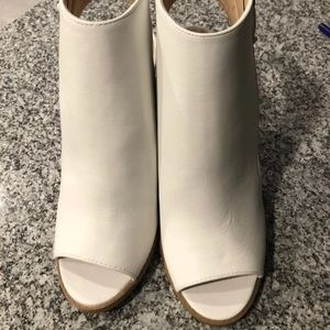 White peep toed booties. NEW.